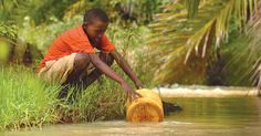 Eric, a sponsored teen in Kenya, collects dirty water that his family will purify with a filter that Compassion donors provided. Walking long distances to collect water takes up a lot of time for women and children in developing countries.
