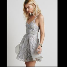ISO Free People Taped Lacey Mini Dress Please tag me if you find it! Small or medium:) Free People Dresses Mini
