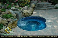 """Spool"" A spool is a small pool and spa conbined. It can be used for cooling off in the heat of summer and made hot on a cool evening. Great for parties! This one has a waterfall, landscaping, and paver patio. See the more at http://www.deckandpatio.com"