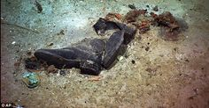 Haunting pictures of boots: The fact that the pair of boots were found so close to each other implies that they were probably on the feet of a Titanic's victim whose body has since disintegrated.