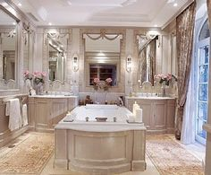 The white ceiling with mouldings, the hints of color in the roses, the creams, greys and whites are so wonderful!