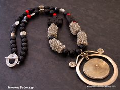 Hmong pendant on a black agate, cinnabar, crystal and hand made wire bead necklace by Caprilicious Jewellery