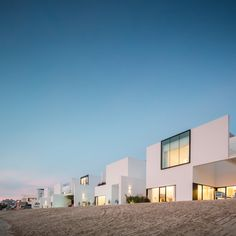 Associated Architects Partnership has created a terrace of five clean-lined white houses overlooking a canal at the Khiran Resort development, in southern Kuwait.