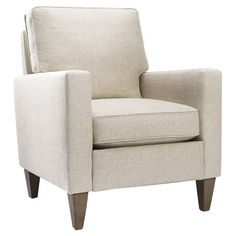 American-made arm chair with exposed legs and barley-hued upholstery.   Product: ChairConstruction Material: Wood...