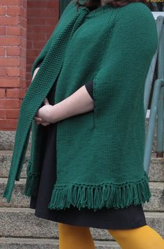 """Free Knitting Pattern for Erin Poncho - This swingy poncho features armholes, fringe, and an open front that's tied off at the neck with seed stitch bands. From the Berroco Design Team. Shoulder circumference – 43½(48-52½- 57)"""""""