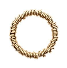 This rolled gold bracelet (hallmarked silver) is a tactile and fun alternative to the Silver Sweetie charm bracelet with an expandable diameter to fit most sizes.