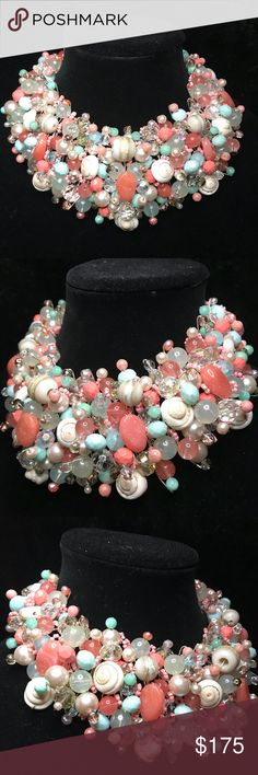 "Wonderful handmade statement necklace😍 Hello ladies🤗 Please give a big round of applause for ""Lana"" as she makes her posh deput!😘 This stunning handmade statement necklace displays coral, aqua, cream, light blue, pink pearls, and spiral seashell beads. ""Lana"" is truly a one of a kind piece. My love for creating her shows in every detail😍 Wow everyone with ""Lana"" gracing the room!😘❤️ Jewelry Necklaces"
