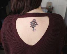 Floral feminist tattoo