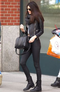 black leather jacket, black skinny jeans, heavy black scarf, white cami, black combat boots