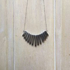 Silver colored hematite statement bib necklace