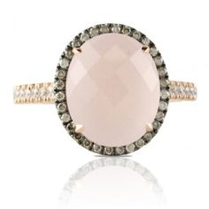Dove Jewelry rose quartz ring with brown and white diamonds!  I love the use of the rose gold as well as the frosted look of the center stone!