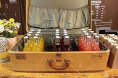 Soda in suitcase - Perfect for a going away party.  I would fill mine with Ice.