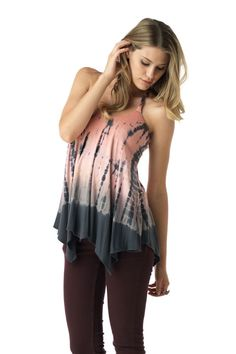 Have fun and feel great in this tie dye halter style top. It features an uneven hemline and braided straps. The braids continue onto the open back and create a woven effect.   Rayon Lycra 93% Rayon 7% Spandex Made in the USA