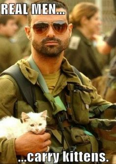 REAL MEN... carry kittens. Its true... but somehow still makes me laugh