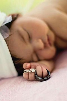 Baby holding rings