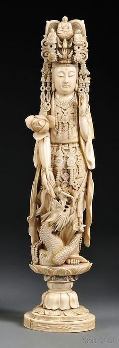 Ivory Carving of Kuan Yin with her left hand in the mudra of appeasement position, right hand holding a lotus blossom, a swirling dragon at feet, standing on a lotus base. Le Morse, Art Asiatique, Art Sculpture, Guanyin, Bone Carving, Buddhist Art, China, Objet D'art, Chinese Art
