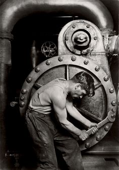 Mechanic at steam pump in electric power house 1920; photo by Lewis Hine