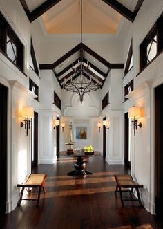 Pinto Designs and Associates' sophisticated Key West style design uses the addition of dark trim around and to add depth to their client's clean color palette, vaulted ceilings and long hallway. Grand Entryway, Entry Foyer, Grand Entrance, Entryway Ideas, Design Entrée, House Design, Design Ideas, Design Trends, Style Key West