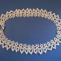 This lacy necklace, trimmed with white glass pearls dresses up any outfit. It is perfect for any occasion from casual dress to a night on the town.  It has been needle tatted from fine white cotton thread with pearls on the peaks of the points to dress it up even more.  The necklace measures ...