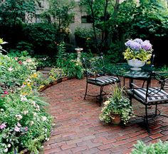 Patio Materials and Designs Brick Cost: Expensive for mortared; moderate for dry-laid. Installation: Professional for mortared; skilled do-it-yourself for dry-laid. Maintenance: Power-wash occasionally to remove moss or grime; repair loose or chipped mo Pergola Patio, Backyard Patio, Backyard Landscaping, Patio Awnings, Garden Pavers, Concrete Patios, Back Gardens, Outdoor Gardens, Outdoor Patios
