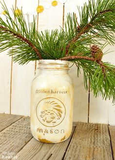 An easy tutorial for how to make your own gold mason jars using gold spray paint and white chalky based paint as well as gold wax. Perfect for your holiday table!
