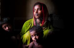 21 year old Sabina Bibi from Gobindopurabab village with her daughter Najima (left) and son Sajid (right). Plagued by underdevelopment the people in Sunderbans delta are at the mercy of tides. Sabina's home is two hours away from the nearest primary healthcare centre which is inaccessible during monsoon to pregnant mothers. Due to lack of any access to proper maternal care, mothers like Sabina have a high risk of losing their babies and even their own lives.     Chhandak Pradhan 2011, India