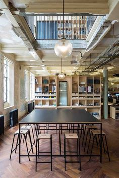 London-based Squire and Partners have transformed a dilapidated 1906 Edwardian building, once the Department Store, into their own spectacular office space. Copper Light Fixture, Copper Lighting, Patio Central, Crittall, Cool Office Space, Workplace Design, Co Working, Architecture Office, Department Store