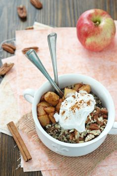 Recipe for apple cinnamon quinoa breakfast bowl. With quinoa cooked in coconut milk, caramelized apples, coconut milk whipped cream and pecans!