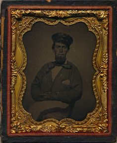 Ninth plate tintype of Samuel W. Weatherall of Pontotoc, Mississippi.  He was a private in Captain John H. Miller's Pontotoc Dragoons that eventually became Cole's Company, 1st Battalion (Miller's) Mississippi Cavalry.  He was promoted to 1st Lieutenant of Company C, 2nd Battalion (Harris') Mississippi State Cavalry and captured near Egypt Station in late 1864.  He is pictured in an early war image with striped trousers and a secession ribbon.  Taken May 6, 1861 at Harrisburg, Mississippi.