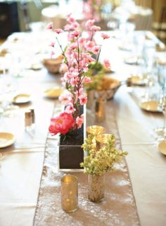 Table centerpieces in cherry blossoms theme