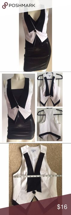 "BEBE black tie vest XS Super cute!!! It's not perfect, has a few very light blemishes but a dry clean could probably get it looking brand new. I priced it accordingly so no low offers please. You will love it ❤️!  Size XS and it's Bebe so is very fitted. I do not fit this, I am a size 4 with a 34C and I can't close it. Length is 19-21"". Bust across 14"". bebe Jackets & Coats Vests"