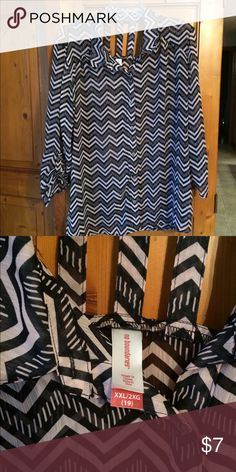 Black/tan long sleeve blouse size XXL Black/tan chevron pattern buttons down the front blouse. Long sleeves that button to make 3/4 sleeves. Peak a boo straps on back. Material is sheer. 100% polyester. No Boundaries Tops Button Down Shirts