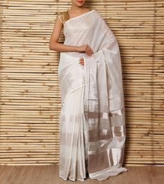 Amodha Offwhite Tissue Saree with Silver Thick Lines Going Through Body