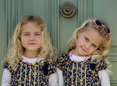 Twins...reminds me of my lifelong sweet sister friends... Beautiful girls...beautiful photograph!