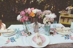 Head table at the wedding of Veronika and Bryan, owners of Tick Tock Vintage.