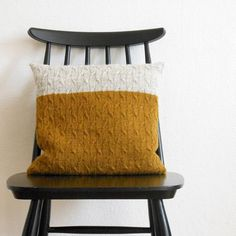 Hygge - Chai Latte is a cable knit square pillow designed to keep you and your tea cup company during lazy evenings: it's mostly mindless 4x1 rib. Yellow and white!