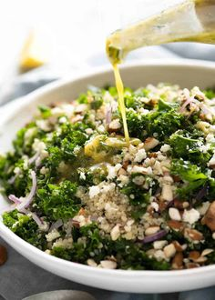 A Kale and Quinoa Salad that happens to star 2 superfoods. The addition of fresh dill and coriander/cilantro and a fresh lemon dressing makes all the difference, as well as a sprinkle of feta and almonds. Kale Salad Recipes, Vegetarian Recipes, Healthy Recipes, Kale Salads, Quinoa And Kale Recipes, Meals With Quinoa, Recipes With Chickpeas, Cooked Kale Recipes, Massaged Kale Salad