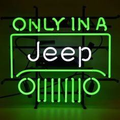 Only In A Jeep Green Neon Sign featuring multi-colored, hand blown neon tubing. The glass tubes are supported by a black finished metal grid which can be hung against a wall or window. It can even sit