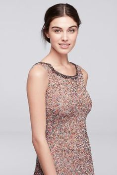 Jenny Packham's designs combine unexpected details with modern elements for a result that's truly unique. This allover beaded dress is no exception, with multicolor beads and sequins atop a pink-hued underlay. Purple crystals define the neckline and V-back.  Wonder by Jenny Packham, exclusively at David's Bridal  Polyester  Back zipper; fully lined  Dry clean  Imported