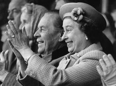 9th May 1985: Queen Elizabeth II applauds enthusiastically as her husband tackles the obstacle course for coaches at the Royal Windsor Horse Show