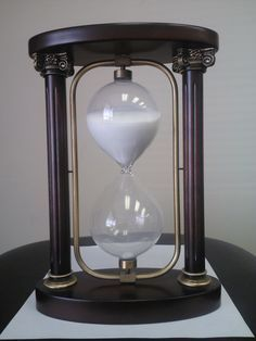 hourglass - wooden oval base