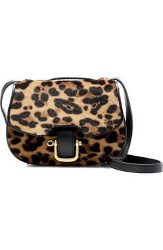 In love with this mini equestrian-inspired bag crafted of Italian leather with leopard-printed calf hair. With an adjustable strap—converting it to a crossbody, shoulder bag or handbag—it offers many smart ways to carry things around for fall.
