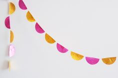cute garland made from foil baking cups.