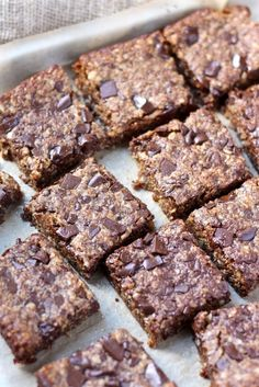 These Vegan Oatmeal Chocolate Chip Cookie Bars are made with quick oats, almond meal and use coconut sugar for a delicious, clean-eating treat. Gluten-free friendly!