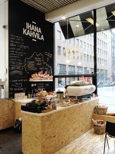Wow. I just love this. The chalk board wall, the mdf fit out, the black and white awning - just stunning.   ihana kahvila