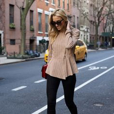 @LISADNYC styled our Manuela Moto Jacket with a statement red clutch