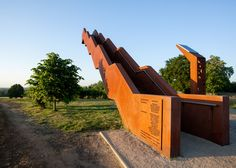 This weathering steel staircase by engineering studio Close to Bone cantilevers off a hill in Flanders
