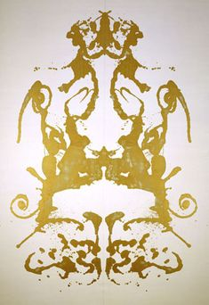 Rorschach - Andy Warhol. (I see a not so amused cat looking up at a ridiculous crown on it's head.)