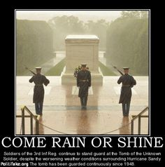 COME RAIN OR SHINE Soldiers of the 3rd Inf Reg. continue to stand guard at the Tomb of the Unknown Soldier, despite the worsening weather conditions surrounding Hurricane Sandy. The tomb has been guarded continuously since 1948.