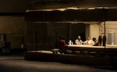 """The third photograph in the series is entitled """"Cantina"""" and is based upon Edward Hopper's Nighthawks. Hopper's painting depicts a couple, a solitary man and of course a diner worker in a New York diner late at night. There has been some discussion over the years in regards to the meaning of Hopper's painting, but to most Historians it has remained very ambiguous…"""